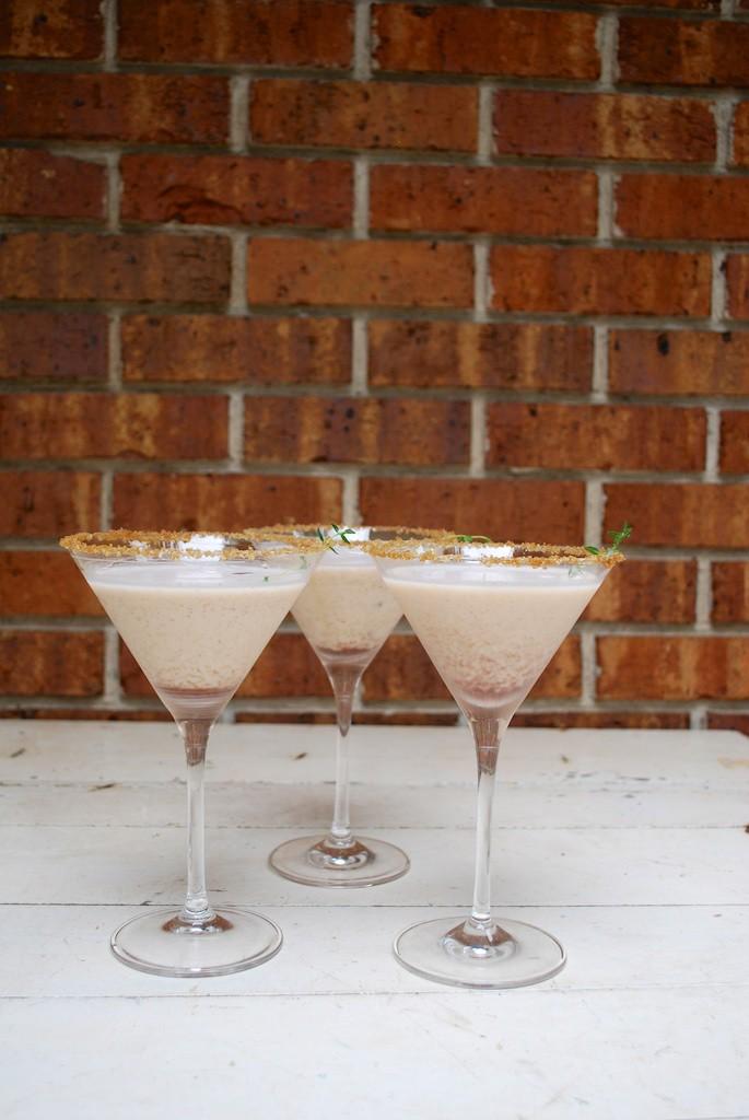 Pumpkin Pie Martinis Garnished with Fresh Thyme